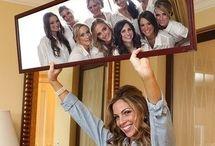 bride holding mirror bridesmaids