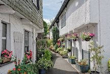 Explore... Hawkshead / Hawkshead is an unspoilt village of traditional Lakeland white washed cottages and narrow streets lined with speciality shops, tearooms and inns.