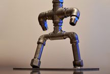 Industrial figures / Figures made of metal pipe fittings. Decorative items