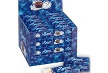 Perugina Baci Chocolate / Perugina's world famous chocolates presented in elegant silver and blue packaging, is the ultimate expression of one's fine taste. Each individually wrapped luscious hazelnut comes with a romantic love note. Remember that Baci in Italian means kisses!