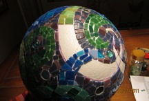 Mosaic Fountain / Made with a polystyrene ball, and covered with glass tiles.  The hose for the pump goes through the center of the ball.