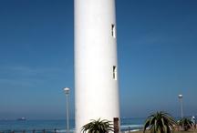 Lighthouses shedding light across the oceans.