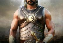 Baahubali (2015) / Baahubali (Prabhas) is an able king and a powerful warrior. But his greedy step-brother Bhallala Deva (Rana Daggubati) kills him to usurp power. Devasena (Anushka Shetty) is in prison. Baahubali's son Shivudu (Prabhas) is brought up in a village. As Shivudu grows up, he learns the facts of his father's death, revealed through a flashback sequence. How he avenges his father's death and ensures good governance for the people of the kingdom forms the crux of the story.