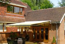 Awnings / We supply and instal made to measure awnings designed and manufactured by world class European companies ; particularly Markilux , Weinor and Gibus .  We are approved installers and all awnings benefit from comprehensive manufacturers guarantee .    Manual , electric remote control , retractable arm awnings, framed awnings, conservatory and window awnings . Huge choice of traditional & high tech awning fabrics , comprehensive lighting , heating, sound system , and automation options.