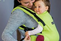 Isara Colimacon full wrap conversion / This wrap conversion perfectly combines the beauty and comfort of a woven wrap with the ease and support of a SSC. ISARA is an ergonomic soft structured carrier for babies and toddlers, which is truly different compared with other products on the market. The adjustable seating represents the biggest novelty of the ISARA carrier. The body of the carrier is also adjustable, it can be lowered or raised, on both sides or even asymmetrically.