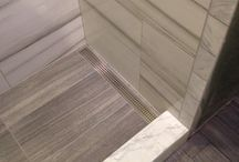 Linear Drain Showers - Tile Design / We love the linear drain in shower design because it allows for larger size floor tile to be used. The slope is simple, clean, and elegant.