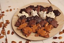 """Chattahoochee Snappers """"Turtles"""" / Mmmmm, nothing beats fresh pecans coated with mouthwatering caramel that is then drenched in creamy milk, white or dark chocolate! We even top some with sea salt! It's so delicious!  www.hanselandgretelcandykitchen.com  1-800-524-3008"""