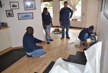 InstaLay in South Africa! / The Kronotex Exquisit Laminate (8mm) flooring being installed onto IL30lg (InstaLay 3mm low-grab) to a 135m2 (1450 ft2) project in Hilton, South Africa.    IL30lg is an innovative and environmentally friendly underlayment system manufactured using recycled rubber crumb.  The low-grab adhesive membrane allows for a continuous bond between InstaLay and the Laminate which delivers exceptional levels of acoustic performance, whilst also providing superb underfoot comfort.