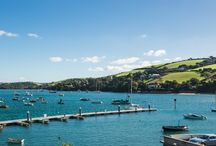 1 The Strand - Salcombe / This stunning home, located in the very heart of Salcombe and only 25 meters from the water's edge, sleeps up to 8 in its 4 upscale bedrooms. It overlooks Normandy pontoon, a buzzing hive of activity and culture, while still providing all of the tranquility and privacy you require.