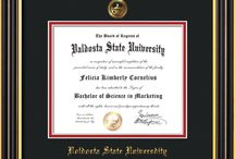 Valdosta State University Diploma Frames & Graduation Gifts / Official VSU Diploma frames. Exquisitely crafted to exacting specifications for the VSU diploma. Custom framed using hardwood mouldings and all archival materials, including UV glass to prevent fading from sunlight AND indoor incandescent lighting! Each frame exceeds Library of Congress standards for document preservation and includes a 100% lifetime guarantee, ensuring that a hard-earned achievement will be honored and protected for generations. Makes a thoughtful and unique graduation gift!