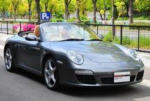 Porsche 911 Carrera Cabriolet (type 997) / 年式 2009 シフト 6速 ハンドル R 初度登録 平成21年4月 排気量 3,600cc 走行距離 113,400Km 車検期限 2年車検受け渡し ミッション MT 修復歴 なし カラー(外装) メテオグレーメタリック/幌:ココアブラウン カラー(内装) サンドベージュ  装備オプション ショートシフターキット LSD シートヒーター スポーツクロノパッケージ メーラーパネル(スポードイエロー) PASM 19インチカレラクラッシックホイール