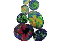 Opals - Black Opals from Australia / Natural, solid, black Australian opals are available in set and un-set form at Giulians. Have designs custom-made to order during your Sydney visit. Worldwide shipping is also available.