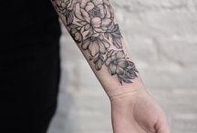 Mel Tattoos