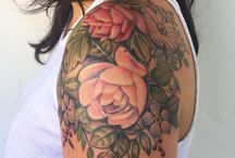 FAMILY FLOWER TATTOO / I would like a tattoo of a cluster of flowers for my birth month(June) as well as my husband(Feb) and my son's(Oct.) I would like to have a rose on the shoulder that is red, to mimic my son's Birthmark (see photo) then the other flowers and more roses/rose buds can fill in the tattoo.