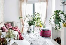 Charming small apartment is cozy and decorated with feminine aura