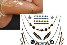Aranytetoválások / A fémfüstből készült tetoválás csillogó és fényes felülete kiváló és érdekes kiegészítője lehet a normál ékszereidnek is! Érdekes, tükrös hatása rendkívül figyelemreméltó akár éjszaka is.