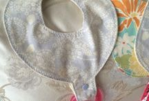 Baby bibs with pacifier patterns