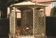 Wooden Garden Gazebos / Elegant wooden garden gazebos with side panels for creating secluded and shaded garden seating areas