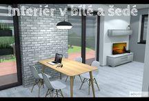 Světlý interiér v bílo šedé. Kuchyň spojená s obývacím pokojem.