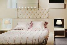Sissi Bed by Paolo Castelli S.p.A. / Letto con sommier in legno, imbottito con polietere espanso flessibile da blocco, rivestito con fibra di poliestere. Angolari in acciaio. Rete in acciaio con doghe in faggio.Piedini in polipropilene
