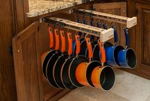 Glideware hangs your pots and pans inside your cabinet so you can display them only when you want to. Cookware storage. www.glideware.com / Pot and pan hanging storage rack. Extend the life of your cookware. . . hang it!  www.glideware.com