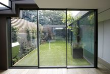 Project: Garden Room House Richmond / minimal windows sliding doors to three sides of a courtyard at this residential renovation. The sliding doors slide in multiple configurations to allow many different movement paths through the space. This extension was designed by Paul McAneary Architects.