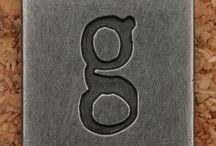 {letter G + letter g}