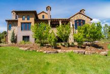 8425 Raphael Lane Littleton, CO / Italian posh meets Colorado rustic in this 5,500 finished square foot four bedroom, six bath Tuscan-style home featuring a three-car garage, custom finished lower level and picturesque mountainous views in Littleton's highly desirable Italian-themed gated Ravenna golf course community. This pristine natural stone and stucco estate just 30 miles from Denver and close to Chatfield Reservoir, Waterton Canyon, the Audubon Society and the famed Red Rocks Amphitheatre. Offered at $1,995,000