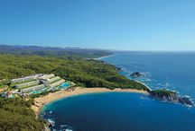 Secrets Huatulco / Along a 22-mile stretch of the Pacific in Huatulco are nine spectacular bays. Conejos Bay, with its golden sand, beautiful rock formations and sapphire waters, will soon welcome Secrets Huatulco Resort & Spa. Here, the exceptional amenities and services of Unlimited-Luxury® start with unlimited food and premium beverages from eight reservation-free, gourmet restaurants and six stylish bars and lounges. https://www.unlimitedvacationclub.com/Resorts/Secrets/SecretsHuatulcoResortSpa