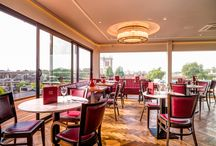 SIX Panoramic Bar and Brasserie / Located on the top floor beneath The Roof Top Garden of The Varsity Hotel with breathtaking 360° spectacular views across the Cambridge skyline.   The restaurant is open all day serving delicious dishes from our Wood Stone oven, Grill and Rotisserie.We also offer a fabulous range of Cocktails and with over 30 Gins paired with 8 different tonics, all served in an informal setting.