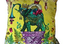 SANTORUS Cushions / Curious and eccentric designs animated with vibrant and flamboyant colours printed on sumptuous velvets and lightweight linens.