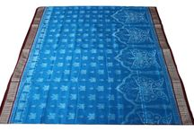 """Sambalpuri Sarees - Bapta, Barpali, Bomkai, Sonepuri, Pasapali and Bapta / Bapta: It's a design of Sambalpuri Saree with a mix of Cotton & Silk weaving.  Barpali: Made from Barpali, a small city in Western Odisha renowned for the weaving of Sambalpuri Ikat fabrics. Bomkai or Sonepuri : These are the traditional designs that was produced in the village named Bomkai of Ganjam district of Odisha. Pasapali: """"Pasa"""" is the game of gambling and the name Pasapali comes from that as the patterns looks like Chess Board."""
