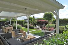 Portfolio tuinontwerp met veranda en witte accenten