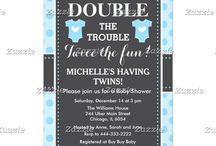 Double Trouble Blue Dots Twin Boys Baby Shower / This design features two baby outfits in blue with a white heart in the center. The background is blue polka dots and a gray chalkboard with a dotted border.