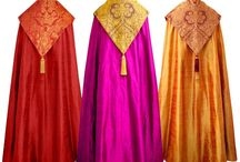 Copes / A long, loose cloak worn by a priest or bishop on ceremonial occasions.