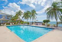 Moon Bay #31 - Cayman Villas / Moon Bay #31 is a second floor unit and sleeps 4 guest. There is one king bedroom, a second bedroom with two twin beds and a deluxe Areo mattress for overflow guests. Each room is washed in tropical sunlight and the common area in the kitchen and living room boasts garden views through sliding glass doors leading to the balcony.