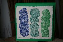 "Lino Cut Print Cards / Hand-made, hand pulled linocut block print designs with Spinning Wheel theme, on antiqued paper, with strips of hand spun, hand woven, naturally dyed wool fabric. Comes with matching envelope, 6""x6"""