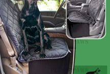 Dog car accessories / Dog Car Seat covers, Door Covers and Co-Pilot (bucket seat) Covers to protect your car leather and upholstery seats from claws, paws, spills, drools, dander and fur.  Available in a variety of colors.  Sophisticated and stylish to compliment new and modern cars and trucks. Padded and Quilted, Waterproof PU, Machine washable, Hammock Convertible and Non-slip silicon backing.  Recommended for both Pets and kids.