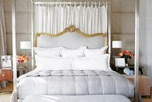 Beautiful Bedrooms / The bed is always the anchor and serenity is always the desired effect. I like a slight off-white, but not a yellow-based ivory. Pale, cool blues and greys to work with sepia toned photography. / by Tara Shaw