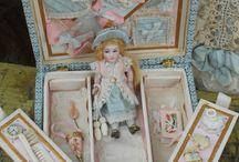 Dolls in trunks