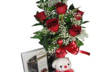 """Love and Romance / Send her a classic! One dozen (or more!) premium red roses in a beautiful vase will let her know exactly how you feel. Or give her a """"bear hug"""" that will last all week by sending a gorgeous bouquet adorned with an adorable plush teddy bear! Try our long-lasting and colorful bouquets featuring an exquisite mix of roses, lilies and springtime flowers, and guaranteed to melt her heart http://www.purplerose.ca/mississauga-florist/love-and-romance#.U1Z93aJudH0"""