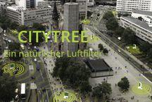 """CityTree: Innovative Luftfilterung durch intelligente Pflanzenfilter / Unser erstes Produkt, der """"CityTree"""", ist ein umweltaktives und smartes Stadtmöbel für grünere und zukunftsfähigere Städte. Eine Anlage kann mehr Feinstaub und NO2 als 275 gewöhnliche Stadt-Bäume filtern, benötigt dafür aber 99 % weniger Fläche und ist 95 % kostengünstiger. Die freistehende Konstruktion verbessert die Aufenthaltsqualität am Platz der Aufstellung, führt zu einer Lärmreduktion und Klimawandelanpassung und vermindert den CO2-Footprint um bis zu 240 Tonnen/Jahr und Anlage."""