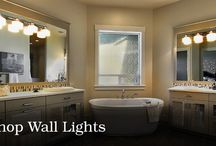 Wall Lights / There are many different types of wall lights that serve a large variety of functions. They can provide task light in a bathroom, ambient light in a dining room, or general light in a hallway. No mater what type of installation, wall lights add a warmth and elegance to any space.