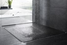 Linear Floor Drains For Bath, Shower & Elsewhere / For years, deco-drains were used in pool and outside deck areas to capture water from rain or the pool and remove it from the deck area. Now, this same idea is avaialble for inside the home in the bath, showers, laundry room and other areas where water needs to be drained without having a central floor drain to get in the way.
