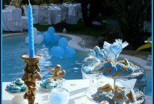 Sweet Corner Cerimonie - Cake design da sogno / Un allestimento prezioso per il battesimo di un piccolo principe. Tutto improntato sui toni dell'azzurro ed oro, TiaCake ha realizzato per il festeggiato, cake pops vaniglia e cioccolato in schegge, macaron alla ganache di cioccolato, frolle al limone, torta alla crema di ricotta, pere e cioccolato. disponendoli sullo sweet table su alzate e vasellame in cristallo, sovrastata da splendi angeli in ceramica e oro.