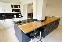 Two Tone Kitchen Design With Large Island / Two tone painted shaker in 'Alabaster' and 'Charcoal', black granite work top with solid oak overlay to create a contrast. Designed, Supplied and Installed by KITCHENCRAFT Witham, Essex