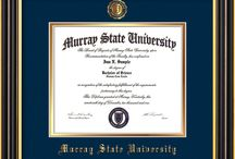 Murray State University Diploma Frames & Graduation Gifts! / Official MSU Diploma frames. Exquisitely crafted to exacting specifications for the MSU diploma. Custom framed using hardwood mouldings and all archival materials, including UV glass to prevent fading from sunlight AND indoor incandescent lighting! Each frame exceeds Library of Congress standards for document preservation and includes a 100% lifetime guarantee, ensuring that a hard-earned achievement will be honored and protected for generations. Makes a thoughtful and unique graduation gift!