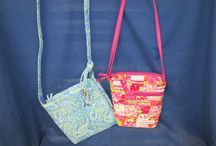 DONNA SHARP PURSES / Wide variety of colors & patterns, purses to carry over the shoulder, across the hip or attached to your belt.