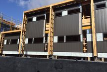 Cantala Apartments | Caulfield North / Express Panel Cladding installed at Cantala Apartments. Colorbond Express Panel Charcoal Alpolic Composite Panel Industry Cladding & Roofing