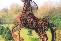 Garden Art Scrap Iron / Generally large statues and sculptures created from Sheetmetal, corten, iron, scrap parts and pieces, repurposed creatively. / by Ann Ayers
